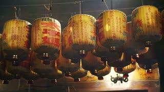 Old classic vintage yellow and brown lamps, Lanterns hanging at a Taiwan, Chinese temple