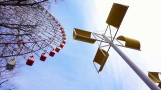 OSAKA, JAPAN - March 2015: Landmark Tempozan Giant Ferris wheel in Tempozan Harbor Village with wind sculpture