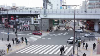 OSAKA, JAPAN - MARCH 2015: -Time Lapse, Aerial View of Pedestrians Crossing Crosswalk Cars Traffic in Japan