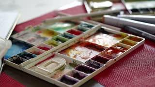 Painting with paintbrush Paint-box, watercolor paints palette, brush