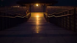 Pathway to the pier by the ocean mountain at night. Abstract hope and light in darkness