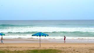 PHUKET ISLAND, THAILAND - July 2015: Phuket beach high wave with tourist walking on vacation destination of Thailand