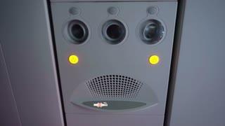plane interior. Passenger signage over head