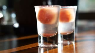 Plum cocktail chilled drink shot