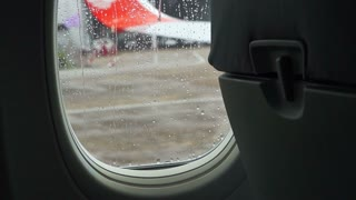 Raindrops on the air plane window with blur airport outside HD
