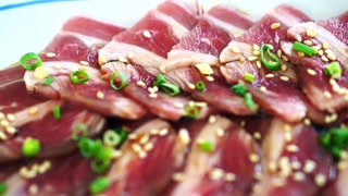 Raw beef slices for barbecue or Japanese style yakiniku