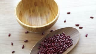 Red and black beans Vegetarian multigrain protein food, pouring to fill the wooden bowl