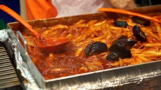 Red spicy rice cake, korean food. White korean pasta with chilli sauce Tteokbokki