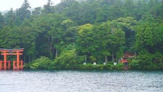 Red tori shrine gate in Ashi lake, popular tourist place of Hakone, Japan