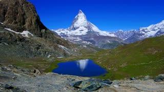 Reflection of the Matterhorn, Zermatt landmark in Switzerland. With lake and bright blue clear sky
