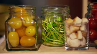 salad ingredients in jars, crispy bread, tomatoes, green vegetable