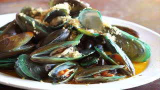 Seafood plate mussel fried with butter and sauce, delicious Thai food
