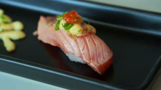 Seared salmon nigiri sushi with cheese and mayonnaise decoration in Japanese cuisine