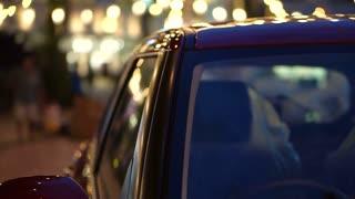 Shiny reflecting holiday Christmas and New Year light on car