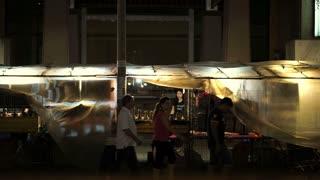 Shot scene in Thailand Night Market. Tourist and local walking around shopping