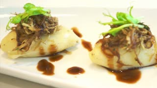 Shredded duck with mashed potatoes course meal dish