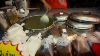 Soybean milk boiling and selling in Asian stall market