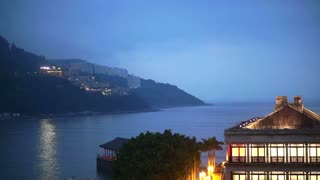 Stanley Beach harbour, Hong Kong: April 2016 - Lighted Murray House and plaza view to the ocean in evening