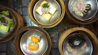 Steaming Dim Sum eating, top view point of variety traditional Chinese food