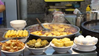 Street food in Taipei, Taiwan. Selling noodle and soup with different topping such as spicy stinky tofu, pork and sausage