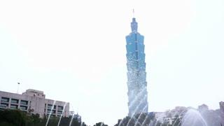 TAIPEI, TAIWAN - February 2016 : Taipei 101 landmark building view from Sun Yat-sen Memorial with fountain and tourist