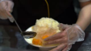 Taiwan Famous Mango shaved ice with ice cream. Tropical fruit cold sweet