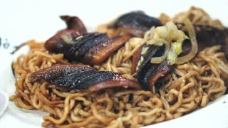 Taiwanese Chinese food eel stir fry with noodle