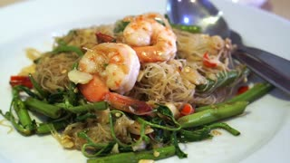 Thai Chinese fusion cuisine, stir fried noodle with vegetable and shrimp