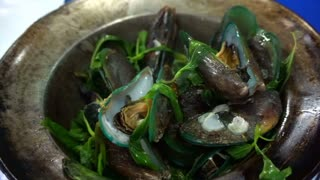 Thai, Chinese seafood baked mussels in the pot with herb