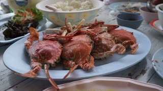 Thai Chinese style seafood. Steamed blue crab and crab meat in curry power