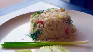 Thai food fried rice with cucumber and green onion