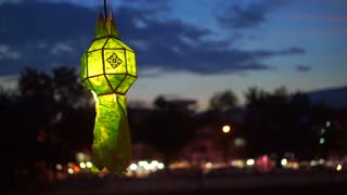 Thai style green Paper lanterns lit decorated in Yeepeng festival with copy space for text ,ChiangMai Thailand