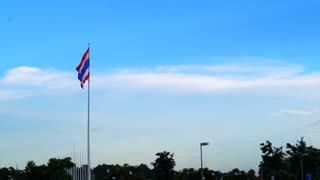 Thailand flag wave with tree and cloud sky background