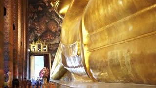 Tourist visit Sleeping Buddha, Reclining Buddha statue in Wat Pho of Bangkok, Thailand