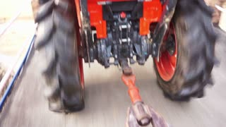 tractor car tow running fast through street action POV scene