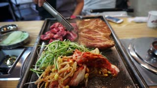 Traditional Korean barbecue and side dishes vegetable food. Grilled on big stone plate