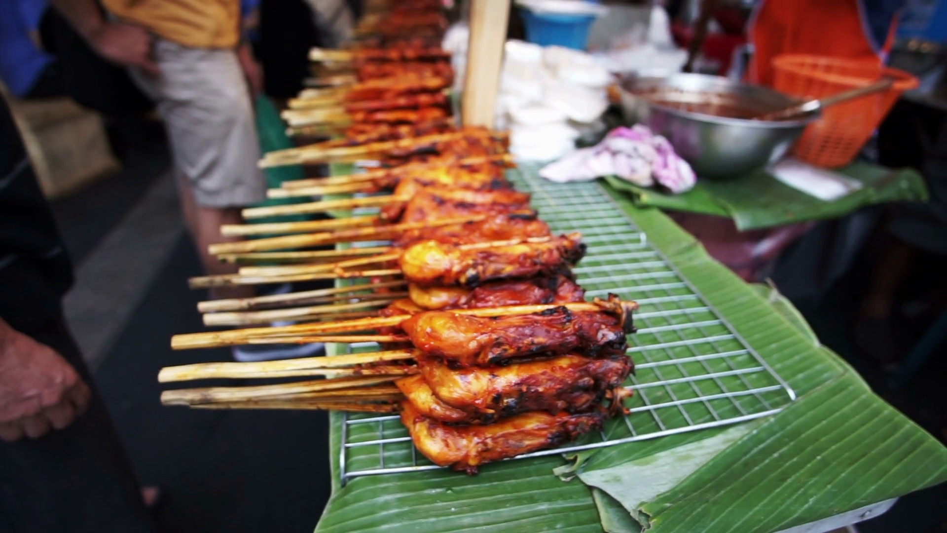 Traditional Thai grilled chicken skewers. Pile of cheap ...