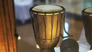 Traditional wood and leather drum of South East Asia in display. Classic music instrument