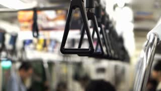 Triangle subway train handles in Japan. Abstract public transportation of Asia