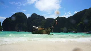 Trip to paradise tropical islands, Krabi,Thailand. Traditional boat at the white sand beach