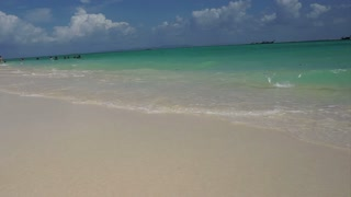 Tropical paradise turquoise blue green sea with white sand beach