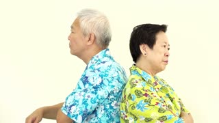 Video Asian senior couple fighting, pouting and get upset to each other on holiday trip