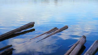 Video bamboo raft restaurant seating in the lake with beautiful blue sky