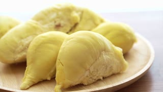 video golden durian King of fruit smelly one on wood texture background