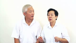 Video of Asian senior couple do not like a deal. Upset and do not satisfy