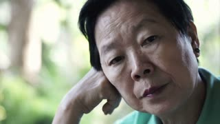 video of Asian senior woman with hand on face thinking, worry and sad