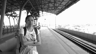 Video of Asian tourist wait for public transportation at outdoor train station