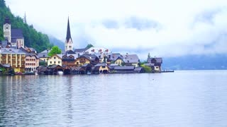 Video of Austria, Hallstatt. Beautiful historic village near lake on the mist day with copy space
