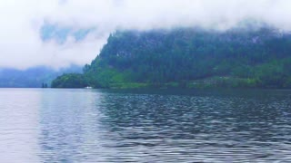 Video of Beautiful Lake Hallstatt in Austria cloudy fog over the mountain