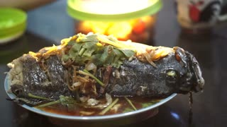 Video of Chinese food style whole fish steam with soy sauce and spring onion